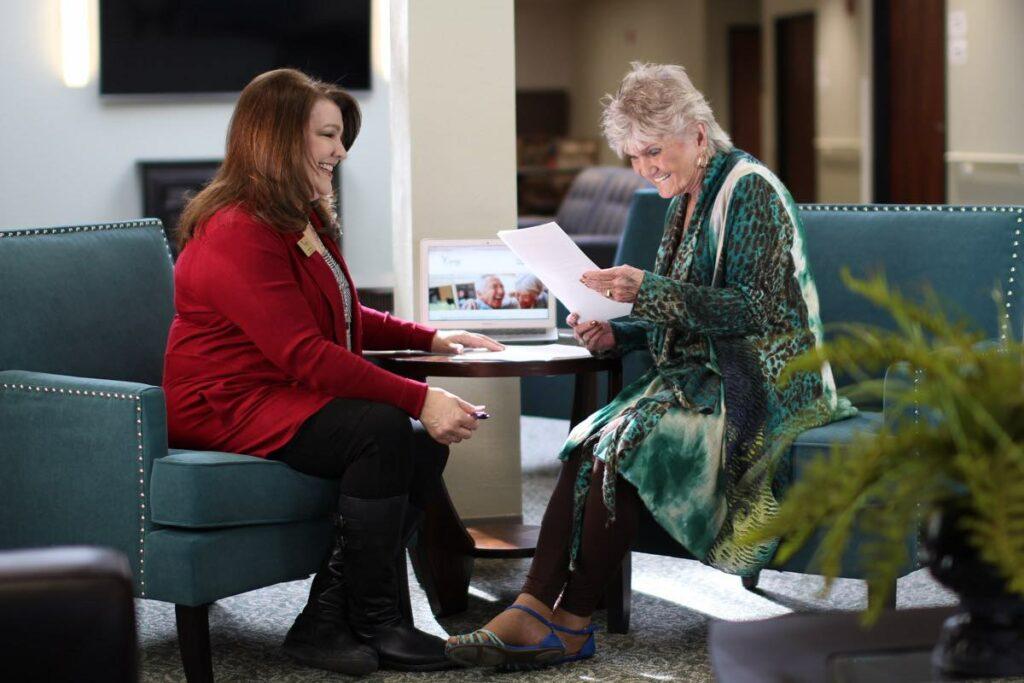 Evergreen Senior Living   Resident reading with associate