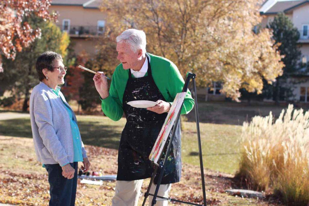 Evergreen Senior Living | Residents painting outdoors