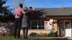 Evergreen Senior Living   Residents waving to adult children