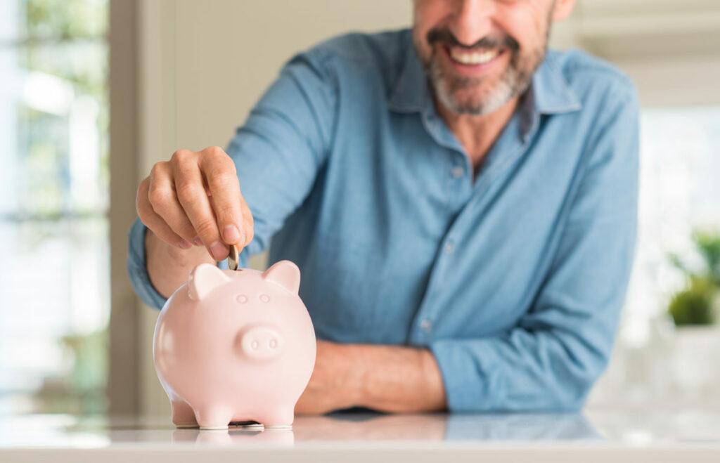 Evergreen Senior Living | Senior man with piggy bank