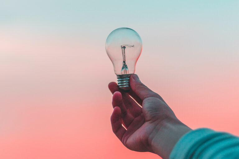 ER Senior Management | Hand holding lightbulb
