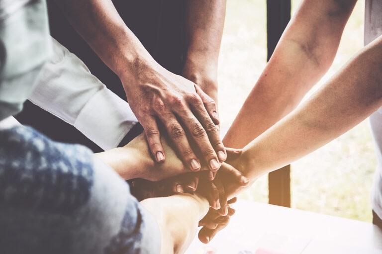ER Senior Management | Group holding hands