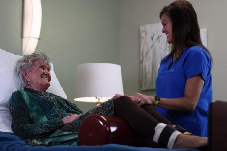 ER Senior Management | Associate helping resident with medical needs