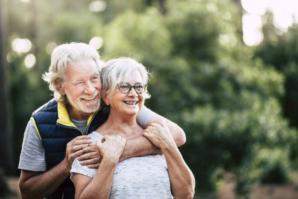 Evergreen Senior Living | Couple smiling outdoors