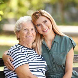 ER Senior Management | Senior with caregiver on bench